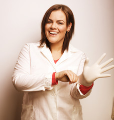 portrait of young pretty doctor in gloves