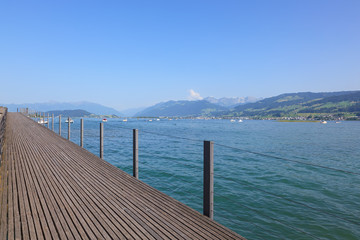 View on Lake Zurich from wooden bridge in Rapperswil