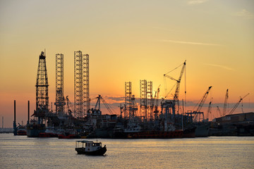 Sunset At A Shipyard