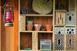 Shelf with insect hotel and garden utensils