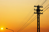 Electricity poles on colorful sky at sunset - 66668954