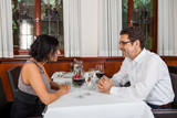 Waiter happily accommodating couple poster