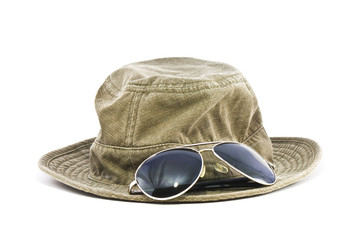 hat and sunglasses isolated on white background