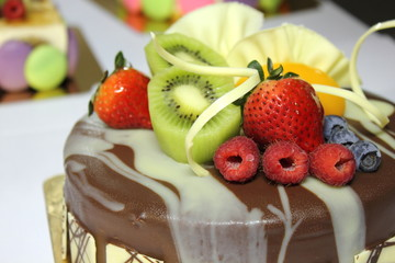 Chocolate cake and topped with fresh fruit.