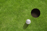 Golf ball near the hole