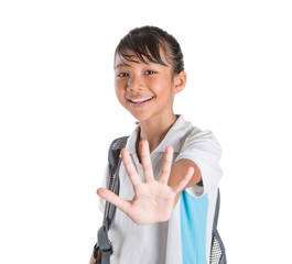 Young Asian school girl with backpack in school uniform