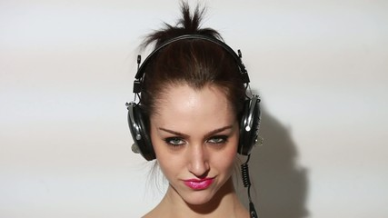 Girl wearing headphones and listening to music