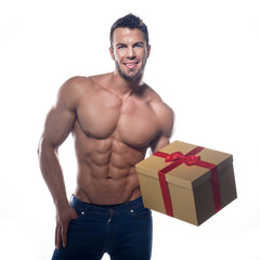 Muscular sexy man with a gift