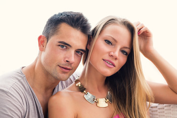 Attractive casual young couple portrait outdoors.