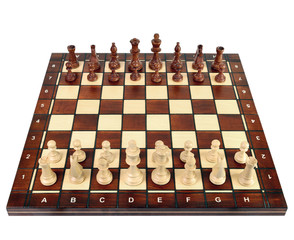 Wooden chess board with chess pieces