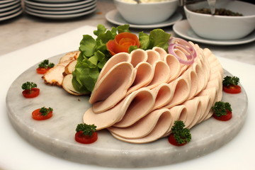 Platter of assorted cold cut slices.