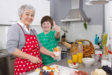 Happy family: Grandmother and grandson cooking together.