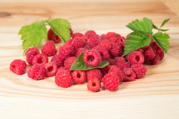 Raspberry berries on wooden background