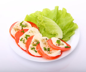 Tomato with mozzarella and salad