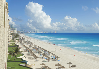 View of beach, Caribbean Sea and clouds in Cancun, Mexico