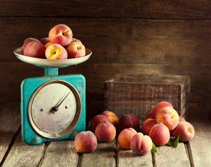 Still life with fresh peaches
