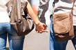 Young couple goes hand in hand in the city