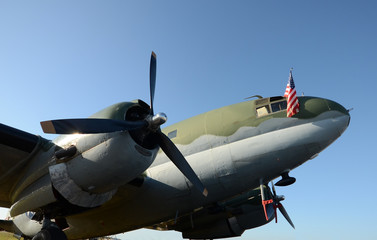 Old propeller airplane nose view