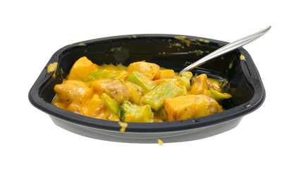 TV dinner of broccoli and potatoes in cheese sauce