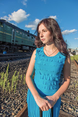 Portrait of the girl on a background of a passing train