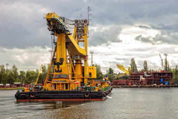 Heavy floating crane in the working port.