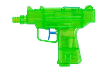 Green plastic water pistol isolated on a white background