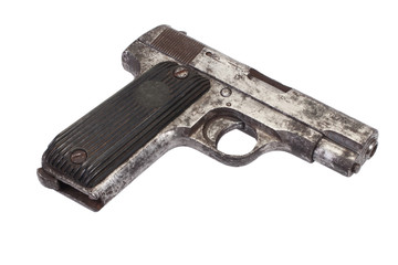 Old rusty handgun on white