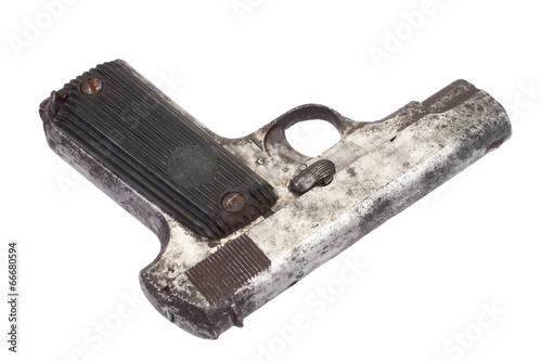 Old rusty handgun on white