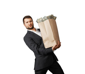man holding heavy paper bag with money