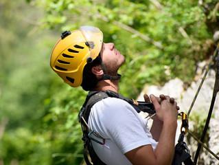 steeplejack climbing a rock wall