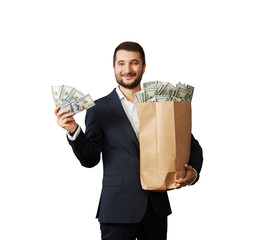 successful businessman holding money