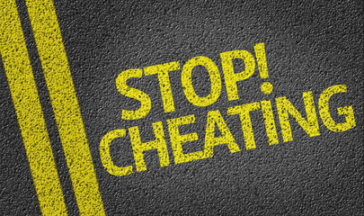 Stop Cheating written on the road