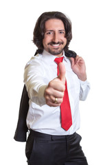 Relaxed turkish businessman with suit showing thumb