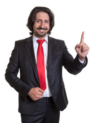 Pointing turkish businessman with suit