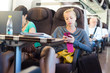 Lady traveling by train using smartphone. - 66682532