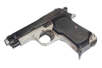 Old vintage handgun on white