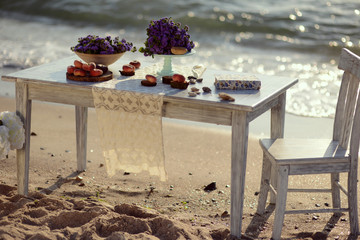 sunrise on the beach in the sand is a table with color and peach