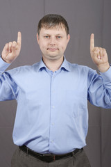 man shows fingers up