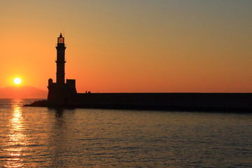 Sunset at harbor with lighthouse Chania Crete