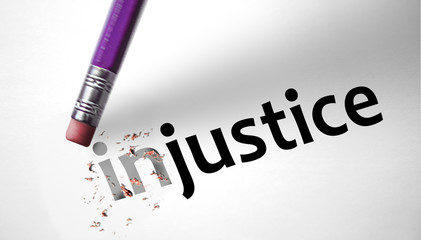 Eraser changing the word Injustice for Justice