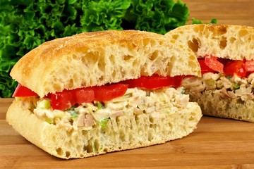 Chicken salad and tomato sandwich on a ciabatta bun