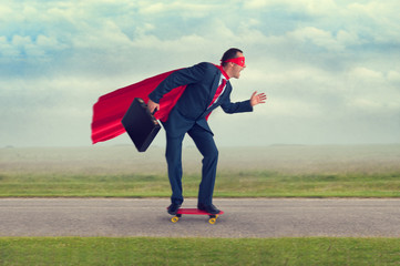 superhero businessman riding a skateboard