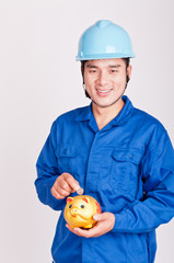 Chinese workers put the money in a Piggy bank