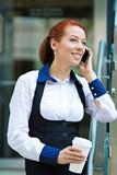 Company woman talking on smart phone, coffee break