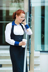 Company woman talking on smart, mobile phone, coffee break