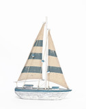 Wooden toy sailing boat on white background