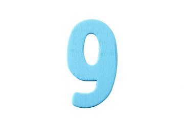 Numbers of wood painted in colorful on white.