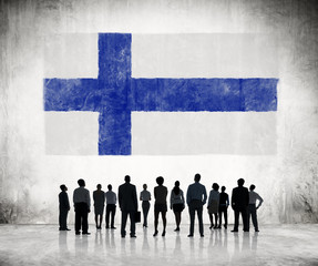 Silhouettes of Business People Looking at the Finnish Flag
