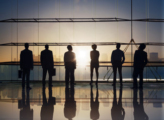 Group of Business People Standing at Boardroom