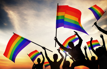 Group of People Holding Rainbow Flags
